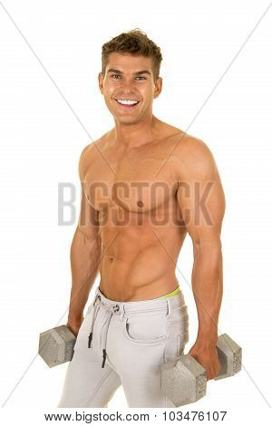 Shirtless Strong Man In Denim Pants Hold Weights By Side