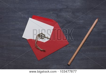 Red Envelope With Key And Pencil