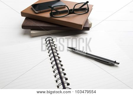 Notepad With Stack Of Book