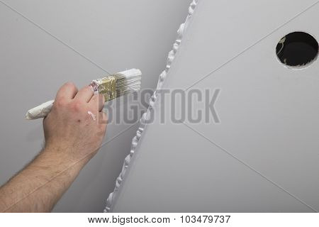 Renovation of house interior. Hand with a brush