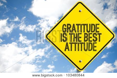 Gratitude Is The Best Attitude sign with sky background