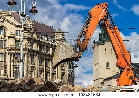 Excavator Loader Machine Works At Center City Of Lviv