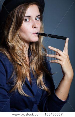 Elegant Woman Holding And Smoking E Cigarette