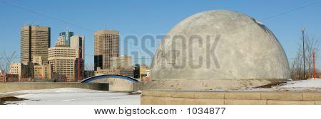Winnipeg Skyline And Back Of Skateboarding Structure.