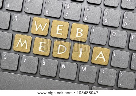 Golden web media key on keyboard