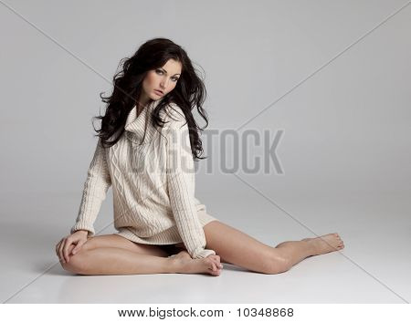 Beautiful Brunette Woman In Sweater Only