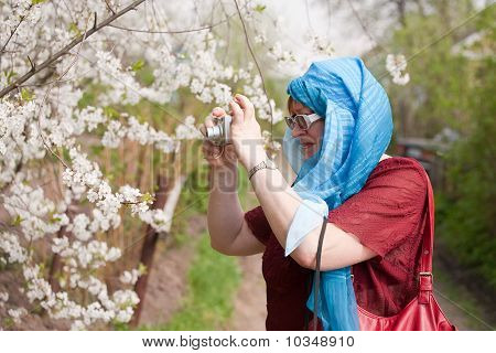 Woman Taking Photos Outdoors
