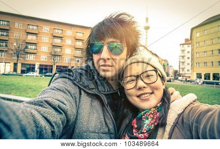 Hipster Couple Of Tourists Taking Selfie In Berlin City - Multiracial Concept Of Friendship And Fun