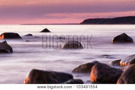 Summer Warm Seascape With Stones And Focus At One Stone