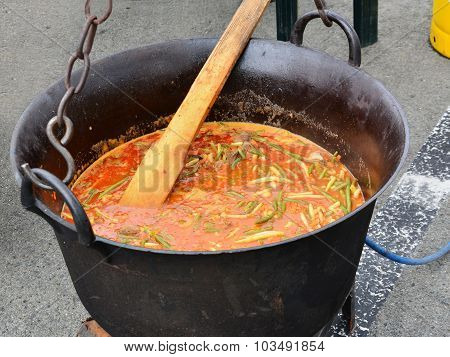 Goulash, Stewed Meat And Vegetables In Cauldron
