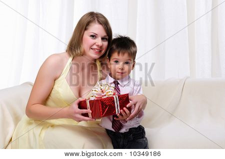 Mom giving a gift to his son