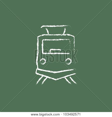 Front view of train hand drawn in chalk on a blackboard vector white icon isolated on a green background.