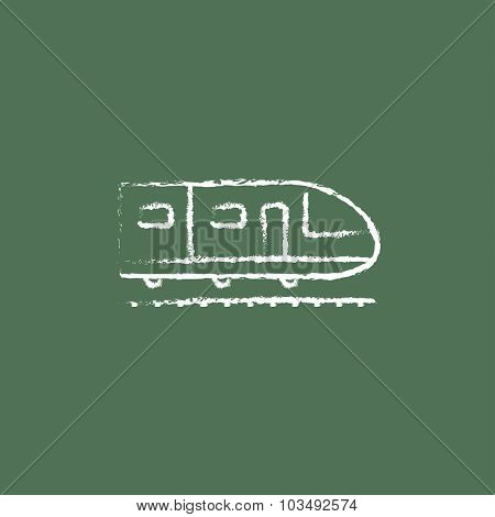 Modern high speed train hand drawn in chalk on a blackboard vector white icon isolated on a green background.