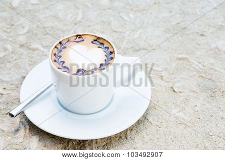 A Cup Of Coffee With Heart-shaped Latte Art