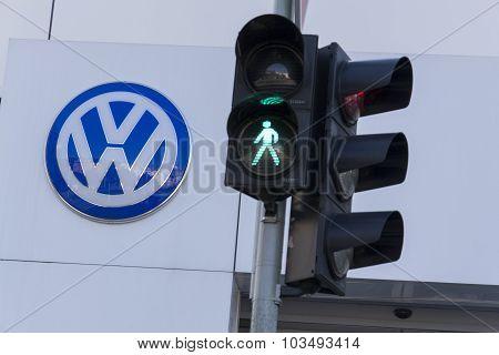 Green Colour On Traffic Light With Volkswagen Car Maker Logo