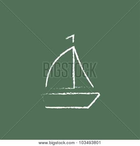 Sailboat hand drawn in chalk on a blackboard vector white icon isolated on a green background.