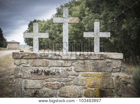 three stone crosses on a wall
