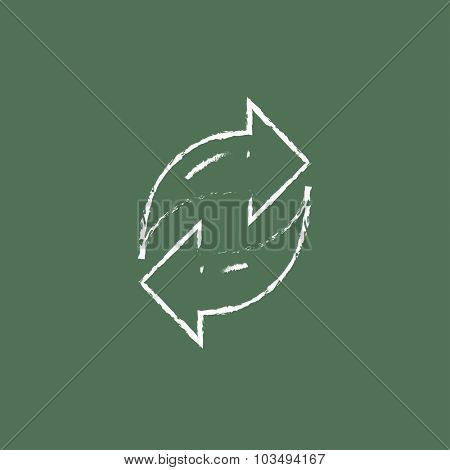 Two circular arrows hand drawn in chalk on a blackboard vector white icon isolated on a green background.