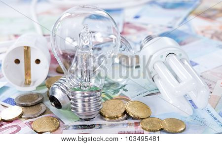 Light Bulbs On Banknotes
