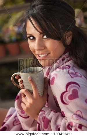 Pretty Hispanic Woman In Bathrobe With Tea