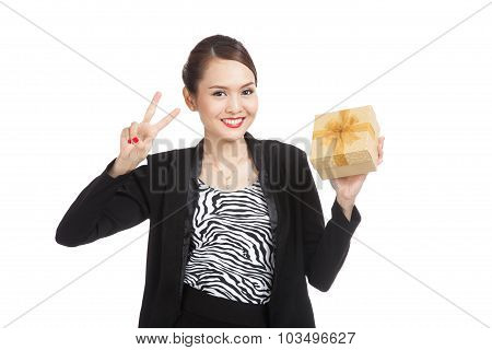 Young Asian Business Woman Show Victory Sign With A Golden Gift Box