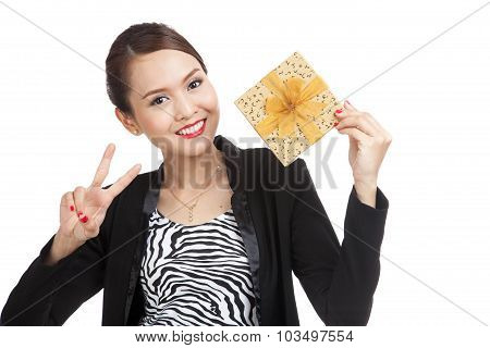 Asian Business Woman Show Victory Sign With A Golden Gift Box
