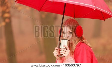 Woman Drinking Hot Coffee Relaxing In Autumn Park