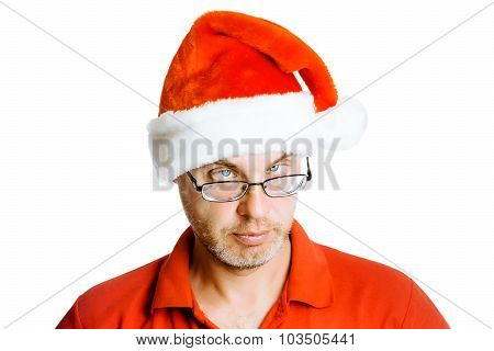 Unshaven Slanting Eyes Man In Santa Hat. Isolated On White. Humor