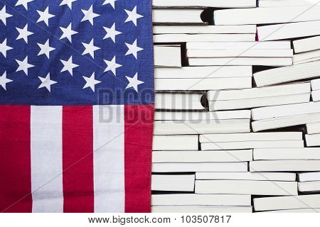 American Flag And Piles Of Books