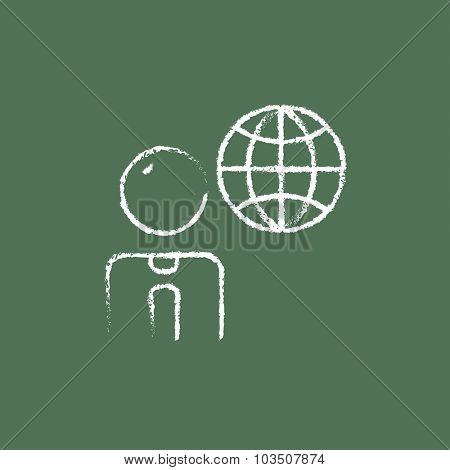 Businessman with globe hand drawn in chalk on a blackboard vector white icon isolated on a green background.