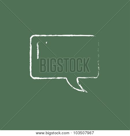Speech square hand drawn in chalk on a blackboard vector white icon isolated on a green background.