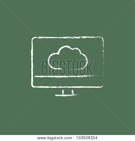 Monitor with cloud hand drawn in chalk on a blackboard vector white icon isolated on a green background.