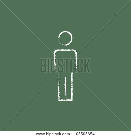 Man standing hand drawn in chalk on a blackboard vector white icon isolated on a green background.