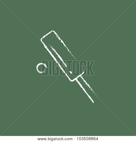 Cricket hand drawn in chalk on a blackboard vector white icon isolated on a green background.