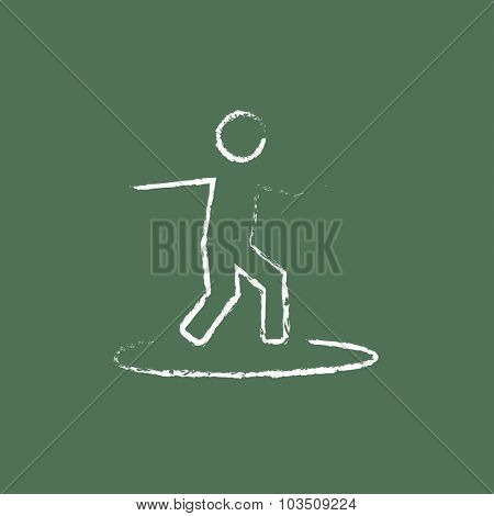 Man on a surfboard hand drawn in chalk on a blackboard vector white icon isolated on a green background.
