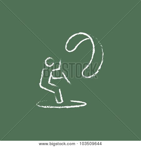 Kite surfing hand drawn in chalk on a blackboard vector white icon isolated on a green background.