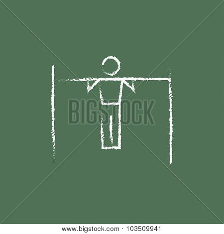 Gymnast on the bar hand drawn in chalk on a blackboard vector white icon isolated on a green background.