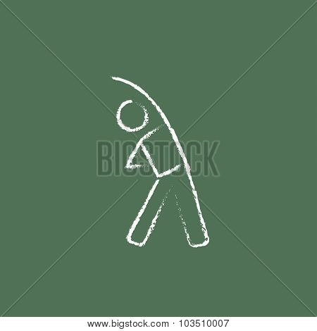 Man making exercises hand drawn in chalk on a blackboard vector white icon isolated on a green background.