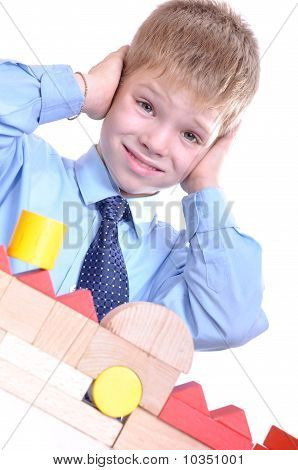 Schoolboy Playing With Bricks