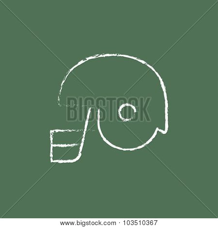 Hockey helmet hand drawn in chalk on a blackboard vector white icon isolated on a green background.