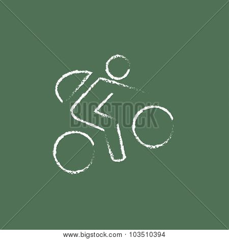 Bike and cyclist hand drawn in chalk on a blackboard vector white icon isolated on a green background.