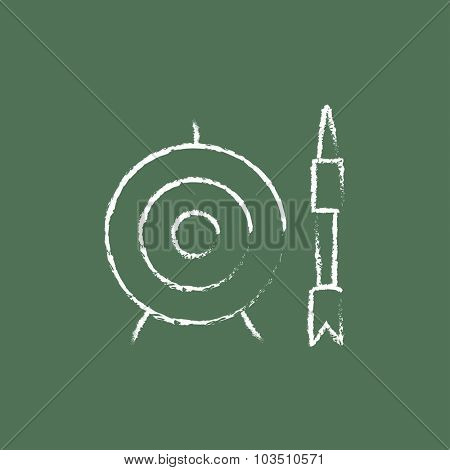 Target board and arrow hand drawn in chalk on a blackboard vector white icon isolated on a green background.