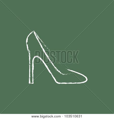 Women's shoe hand drawn in chalk on a blackboard vector white icon isolated on a green background.