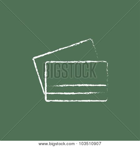 Credit card hand drawn in chalk on a blackboard vector white icon isolated on a green background.
