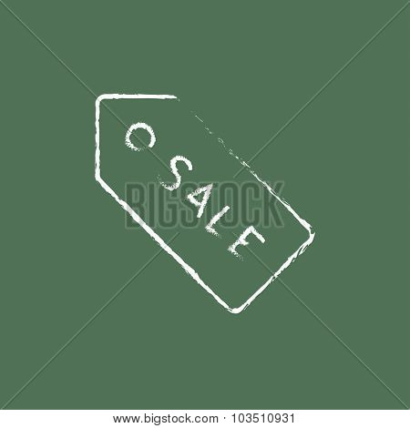Sale tag hand drawn in chalk on a blackboard vector white icon isolated on a green background.