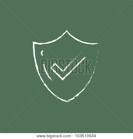 Quality is confirmed hand drawn in chalk on a blackboard vector white icon isolated on a green background.