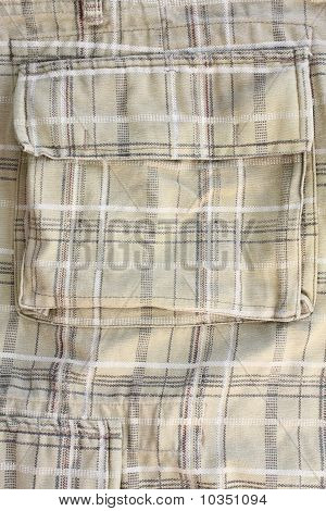 Close up of strip pattern military trousers.