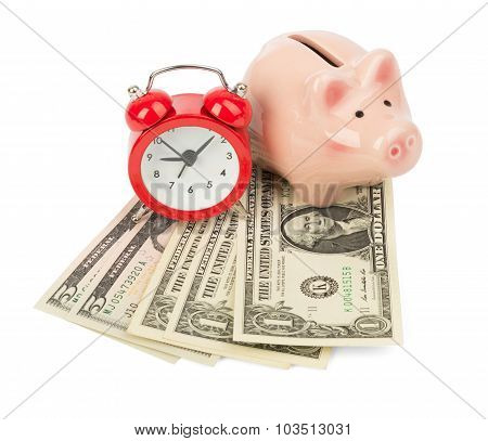 Piggy bank with money and alarm clock, side view