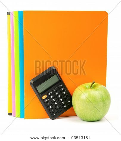 Fresh apple with exercise books and calculator