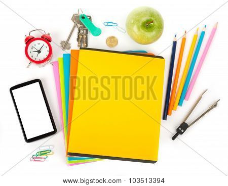 Copybooks with smartphone and office stuff